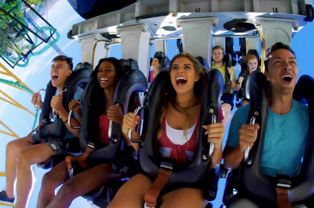 Guests smiling and screaming on Batman the Ride at Six flags