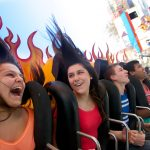 People smiling and spinning on Pandemonium.