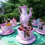 People riding on the tea cups.