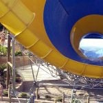 A large orange and blue water slide.