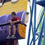 Kids riding a small drop ride.