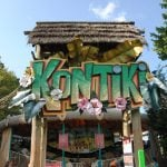 A sign for Kontiki with flowers.