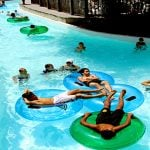 People floating in tubes in a pool.