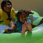 Kids going down a water slide.