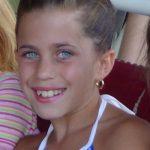 Little girl smiling.