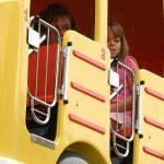 Kids riding in a school bus.