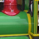 Kids riding in a miniature train.
