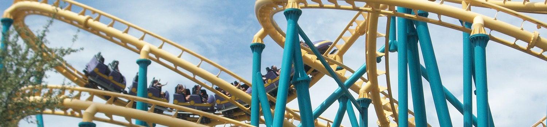 A swirling yellow an green roller coaster.