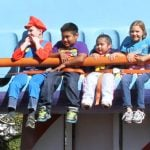 Kids riding a drop ride.