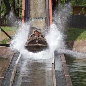guests riding log flume