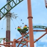 An orange and green roller coaster.