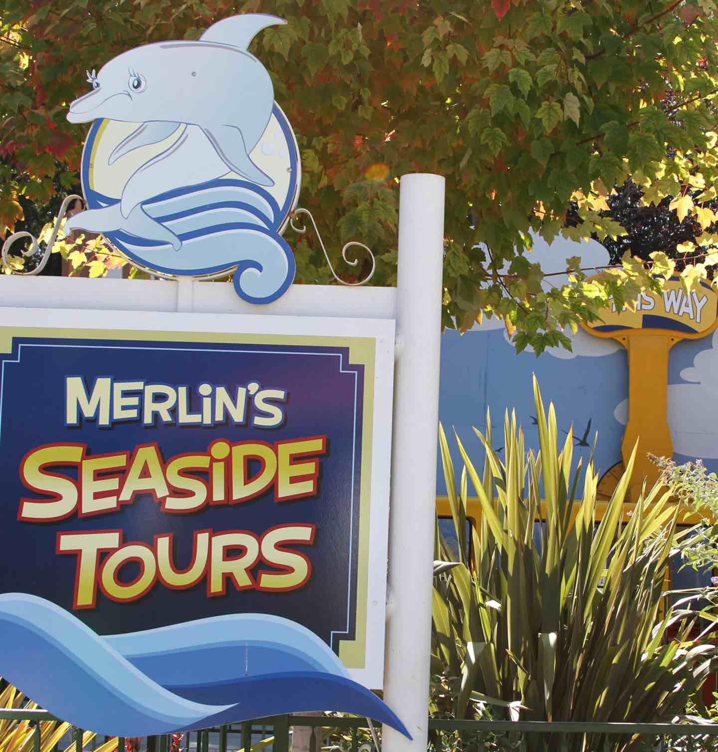 A sign for Merlin's Seaside Tours.