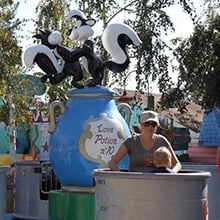 A mom and child in a teacup ride.