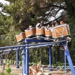 Kids riding small roller coaster.