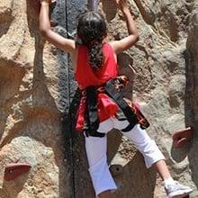 Little girl rock climbing.