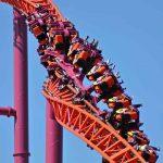 People on an orange roller coaster.
