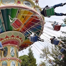 People on a spinning swing ride.