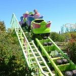 Guests on a colorful roller coaster.