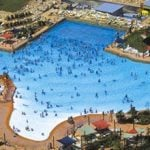 Guests enjoying a Texas shaped pool.