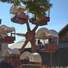 Guests on a wagon ferris wheel.