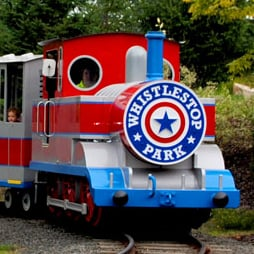 A miniature blue and red train.