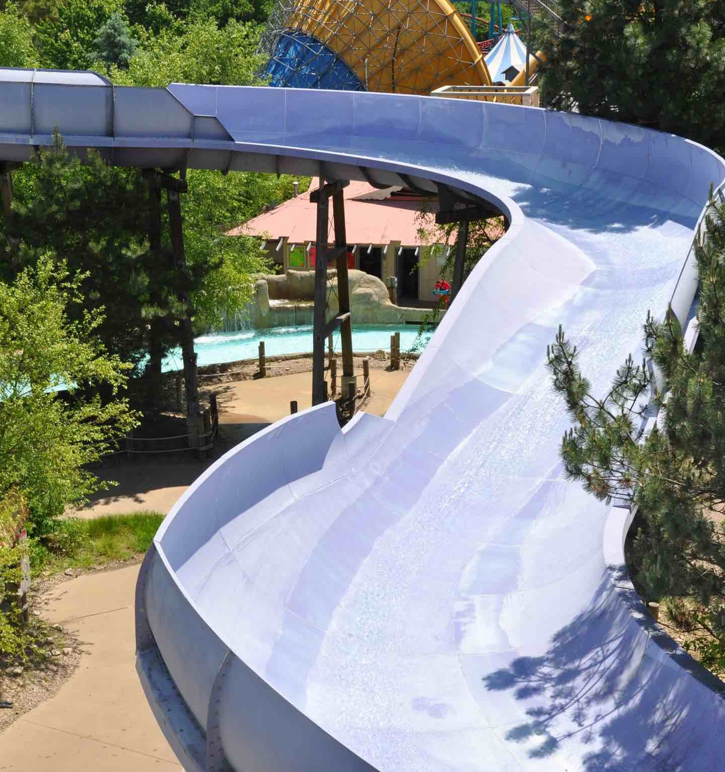 Curving white water slide.