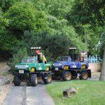 Kids driving mini tractor trailer truck.