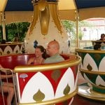 People spinning on the tea cup ride.