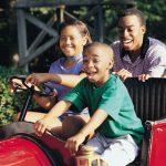 Family riding in an antique rail car.
