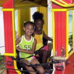 Kids on a miniature train.
