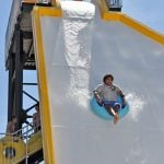 Person going down a waterslide.
