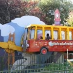 A school bus ride with kids on it.