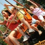 People on a large swing ride.