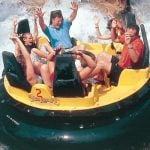 Family riding in bumper boats.