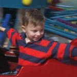 Kids riding miniature planes.