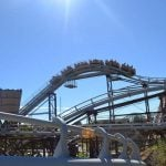 Guests on a roller coaster.
