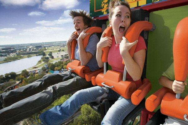 People screaming on a drop ride.
