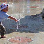 Kids playing in splash pad.
