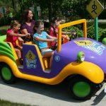 A family riding in a mini car.