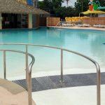 A pool with a cabana.