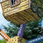 Kids riding in a miniature Ferris wheel.