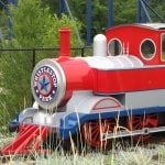 A red and blue miniature train.