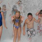 Kids being splashed at Hurricane Harbor Concord
