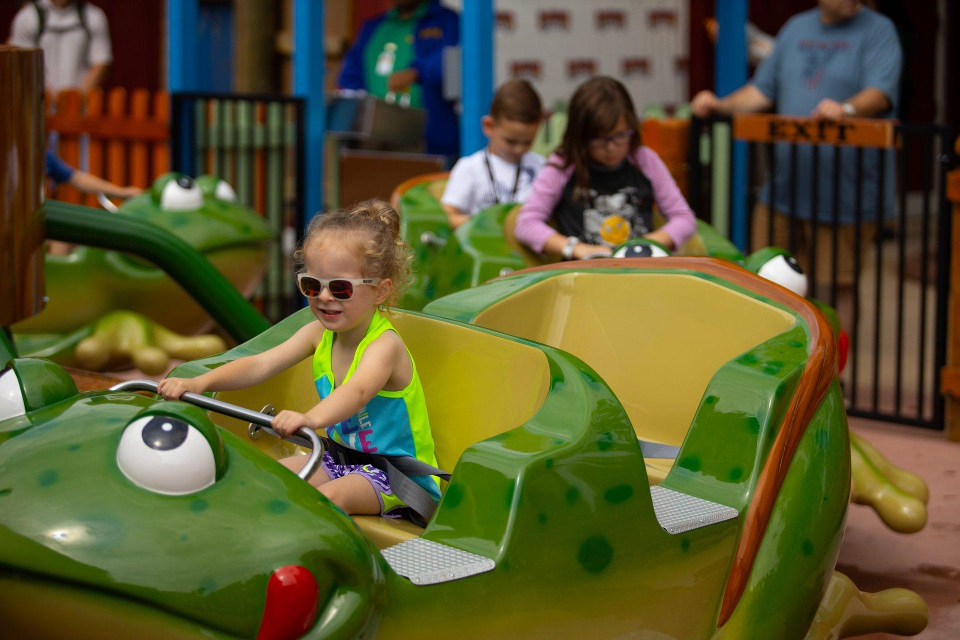 child-riding-frog-hopper