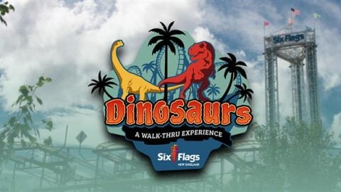 Dinosaurs A Walk Thru Experience logo at Six Flags New England with rides in background