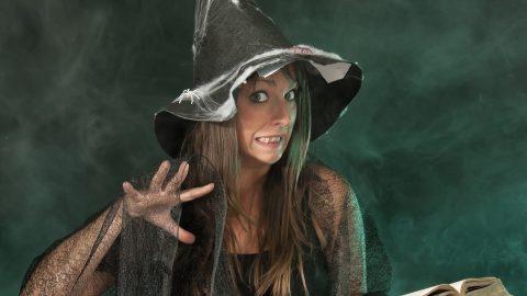 Scary witch reading book