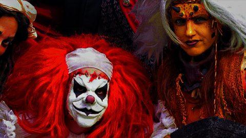 Ghouls at Fright Fest peeking around a gravestone