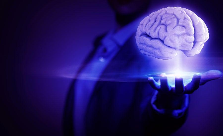 Magician Holding Glowing Brain
