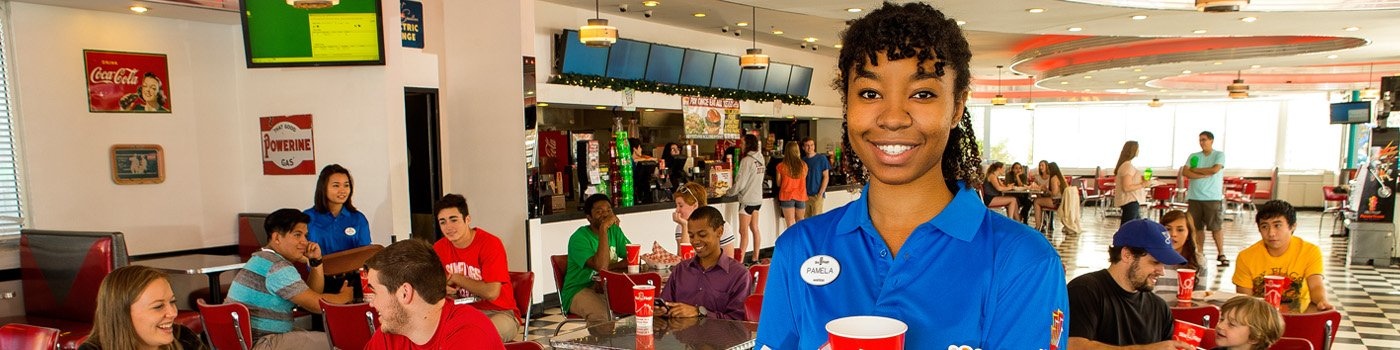 Six Flags is hiring! Six Flags wait staff helping guests at park restaurant.