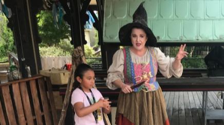 Bridgette Aye Notavittch tells a story to children at Six Flags Fiesta Texas